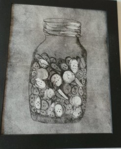 The dry point of the jar of buttons